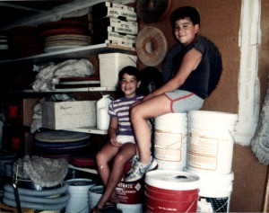 Rachel Sanchez and Jason Dinverno as children, take a rest in the warehouse.