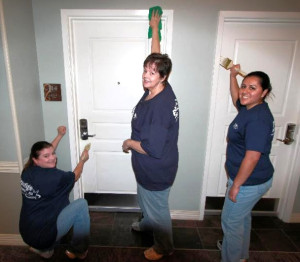 From left, Christi Farrow, Belva Guindon and Carmen   Calderon touch   up residential halls at the Ronald McDonald House of Dallas.