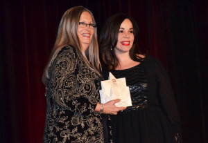 Rachel (right) accepts the WBE award.